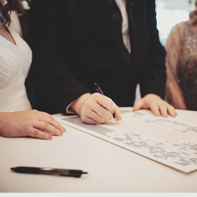 Handmade papercut ketubah for Jewish weddings by Woodland Papercuts. The bride and groom's marriage vows to each other are declared and signed in front of witnesses. Photo by Vivienne Tyler Photography.