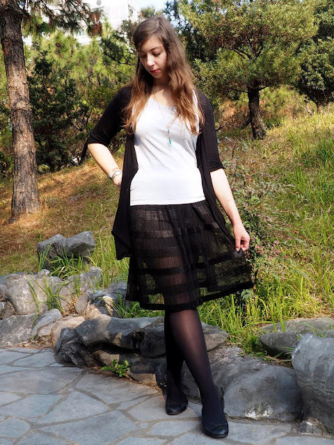 Balletic - outfit of plain grey t-shirt, black cardigan, long, floaty, sheer black skirt, with black tights and ballet flats
