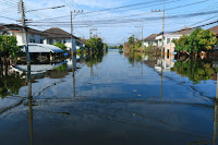 Street under flood waters, Bangkok, Thailand. (Credit: © Tee11 / Fotolia) Click to Enlarge.