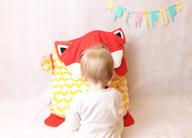 baby with peripop foxey stuffed blanket