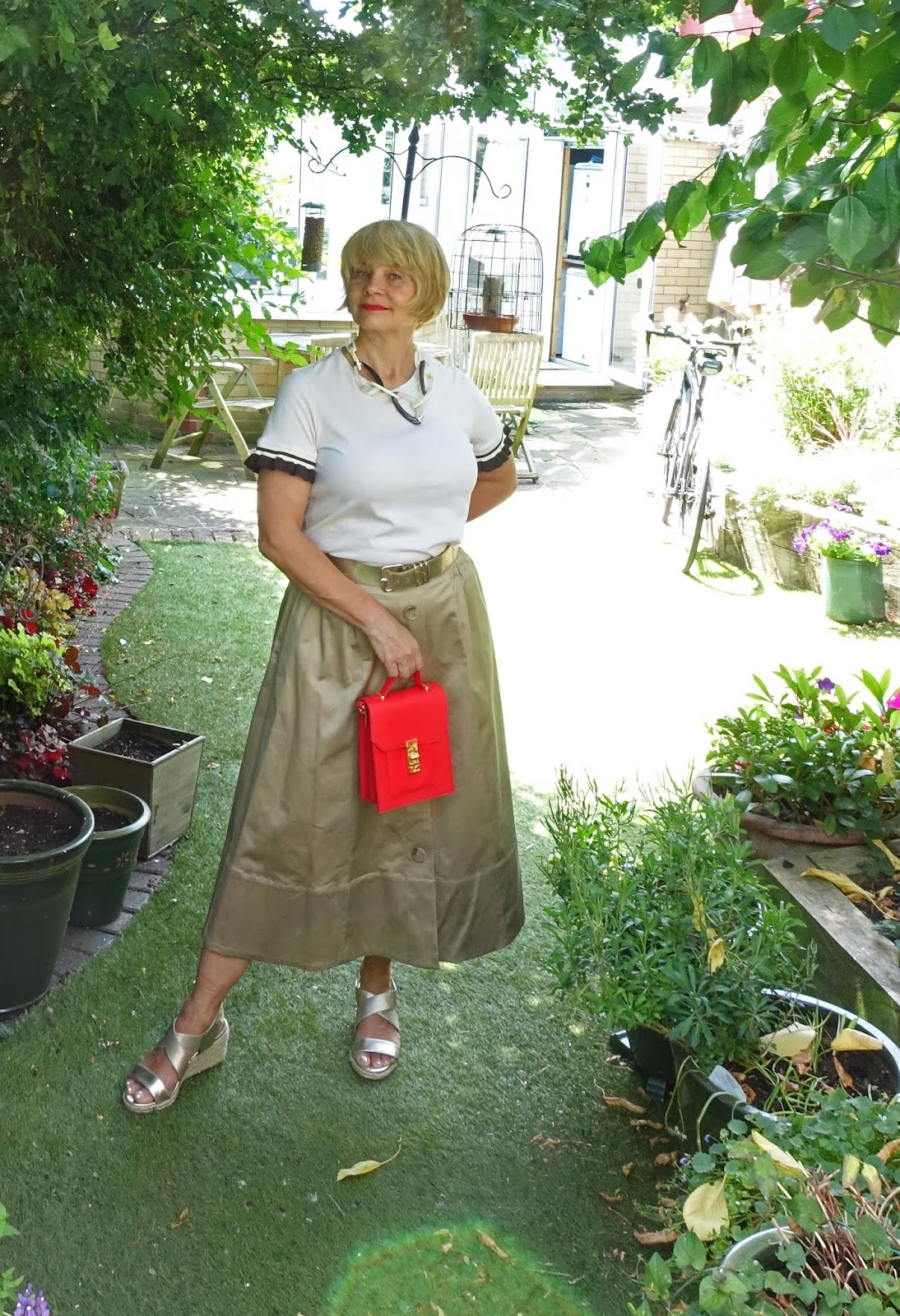 Take a midi length A line camel skirt and create three different looks. Voila! Over 40s blog Is This Mutton takes the supremely soft supima skirt from Marks and Spencer and tries it with lilac and cream and black for the office.