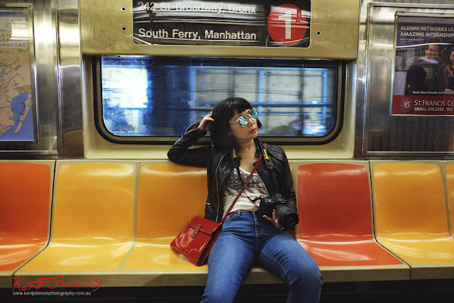 Vivienne riding in a nearly empty the NY subway car, number one line down to South Ferry, Manhattan.  Travel photography by Kent Johnson.
