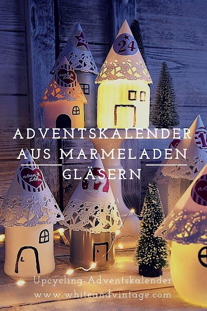 Leuchtende Adventshäuser als Adventskalender