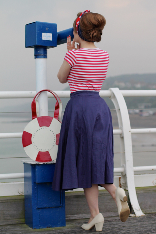Seaside pin-up posing on the pier