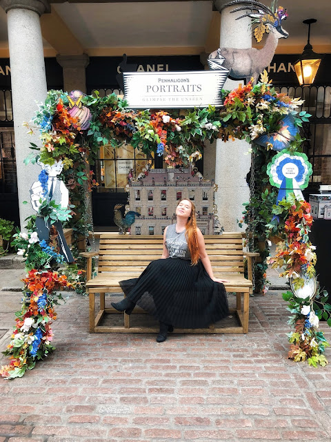 Sitting in a flower display in Covent Garden