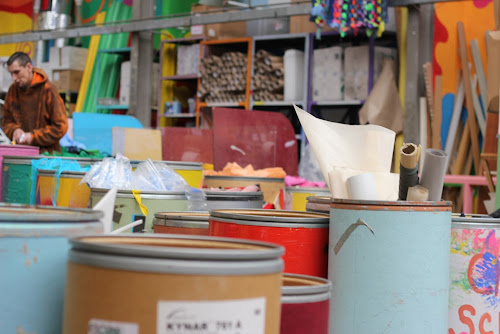 barrels of colourful scrap materials at children's scrapstore