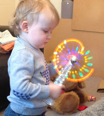 toddler playing with glow stick windmill