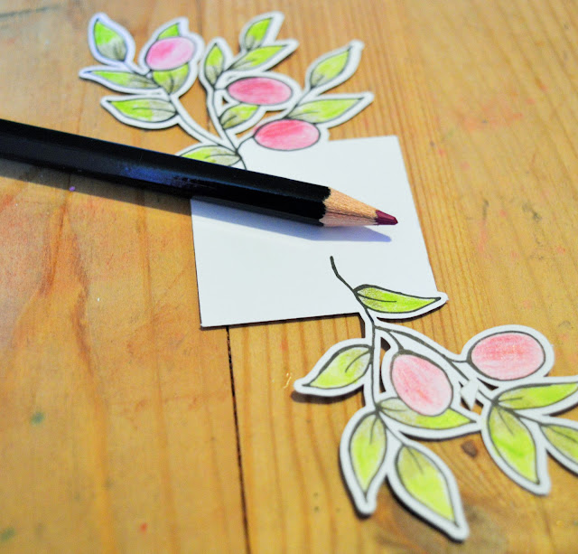 Purple/pink pencil with a leaf cut out coloured in.