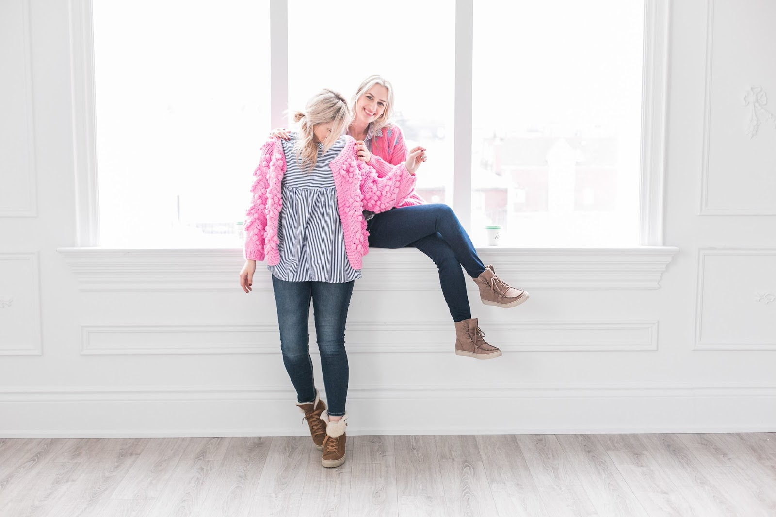 Bijuleni | 2 Transitional Boots You Need For Spring | Sisters wearing matching pink cozy sweaters, skinny jeans and striped shirt.