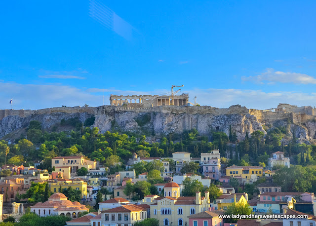 The Acropolis on a flat-topped hill and the pastel-toned houses of Monastiraki below