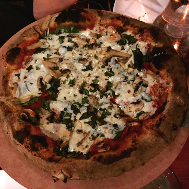 Sun-dried tomato, mushroom and spinach pizza at SLYCE