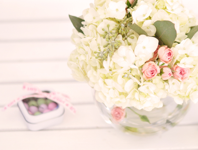pink and white baby shower floral arrangement