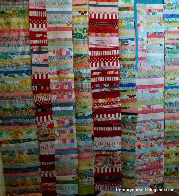 Improv quilt made from columns of strings. Chinese Coins