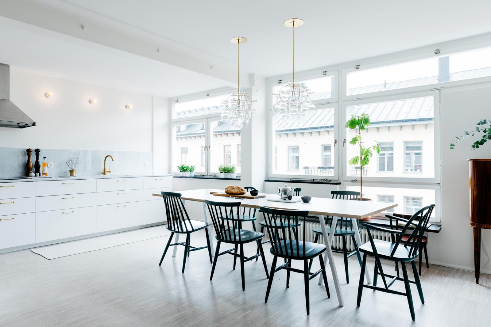 large kitchen area with gold accents and marble tabletop