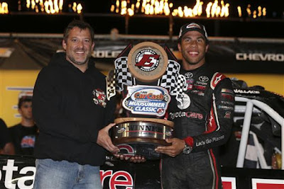 Darrell Wallace Jr. celebrates with Eldora Speedway owner Tony Stewart.
