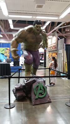 A statue of Marvel's Hulk with with a base bearing the Avengers logo.