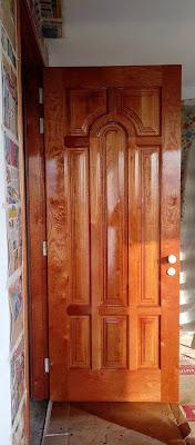 Puerta de madera para exteriores en Surco