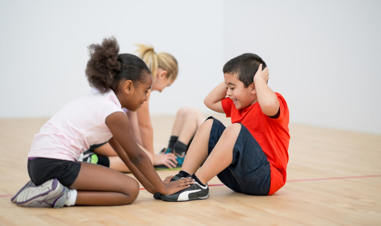 namc montessori Ideas for Non-Competitive Physical Education in the Montessori Environment children stretching in gym class