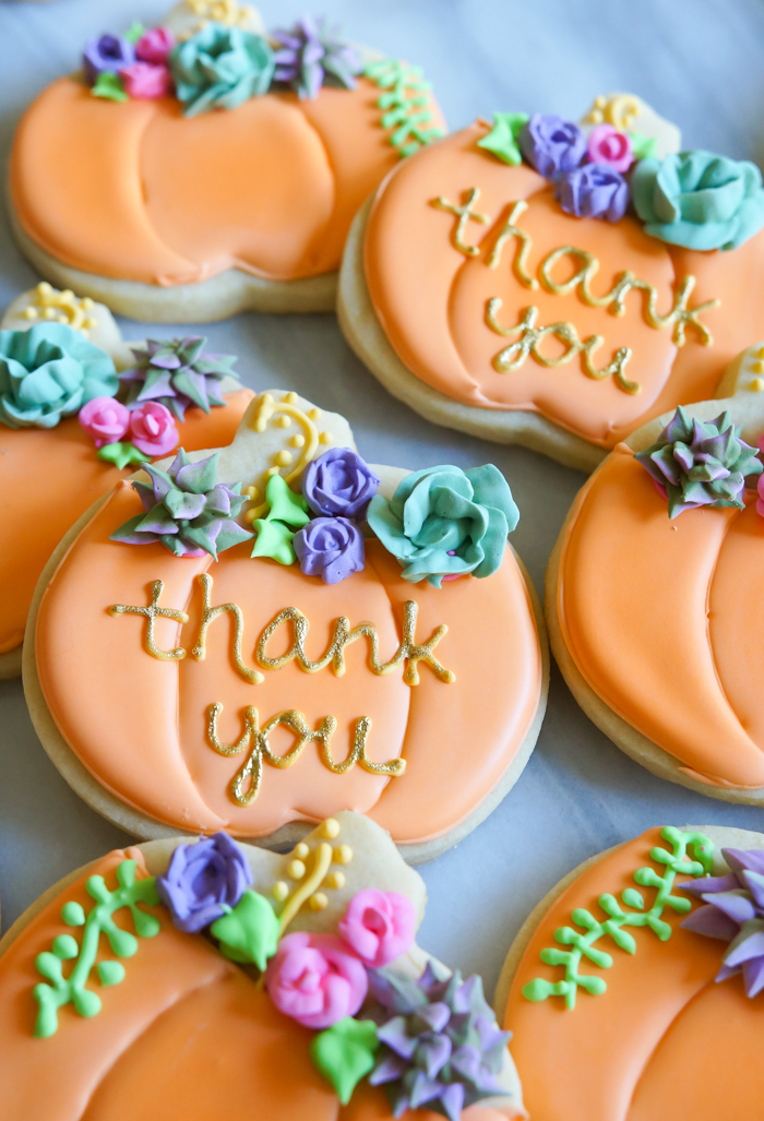 how to make decorated pumpkin cookies with royal icing succulents and roses | bakeat350.net