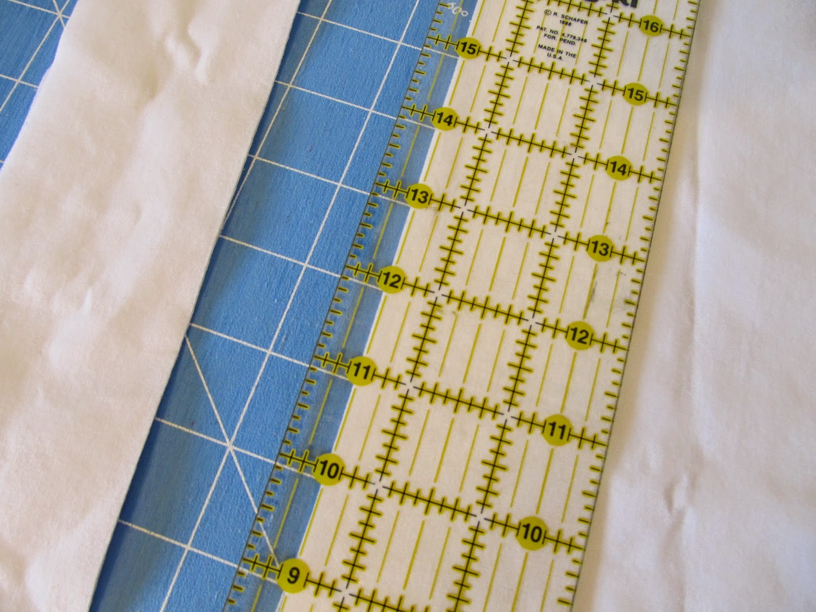 "cutting a 2 1/2"" strip of cotton"