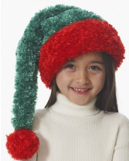 http://www.yarnspirations.com/patterns/child-s-santa-hat.html