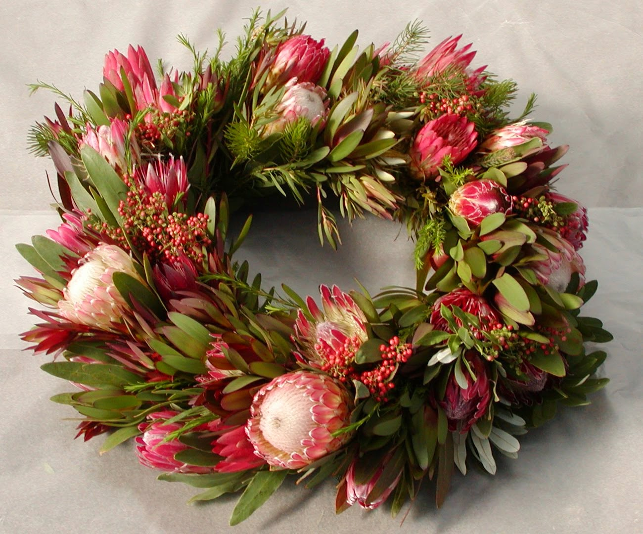 Roses and rust a passion for proteas Designer christmas wreaths uk