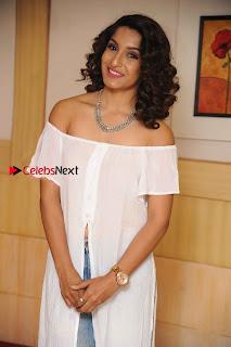 Kannada Model Actress Krishi Thapanda Stills in Ripped Jeans at Eradu Kanasu Movie Press Meet  0007.jpg