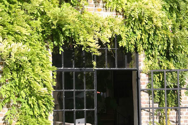 Wisteria surrounding iron and glass doors, Garnier estate, image via Garnier (be) website as seen on linenandlavender