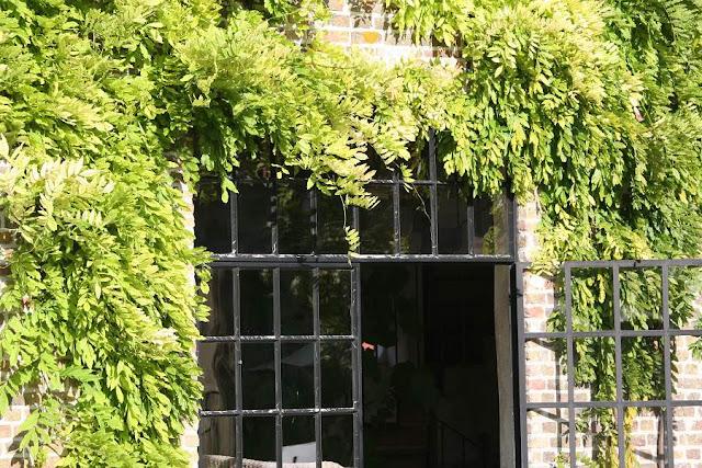 Wisteria surrounding iron and glass doors, Garnier estate, image via Garnier (be) website as seen on linenandlavender