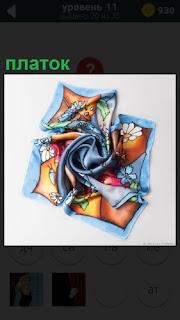 Скомканный цветной платок и красивыми узорами на нем
