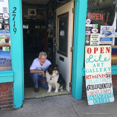 "Bob ""Crocodile"" Lile and dog Lady in doorway of Lile Art Gallery on Route 66 Historic District in Amarillo, Texas"