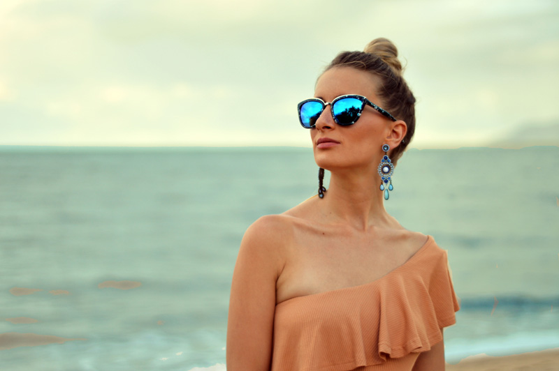 summer outfit one shoulder nude top marble sunglasses girl with blonde top knot