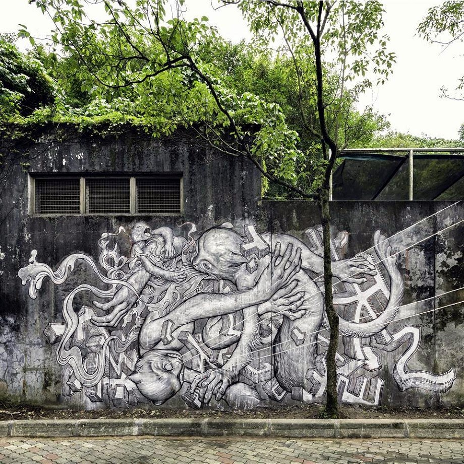 James Jean was invited to participate in the POW! WOW! Taiwan street art festival where he just finished this new piece showing some Taiwanese macaques tumbling in a paradise/prison of man's making. 1