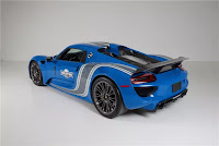 world 39 s only voodoo blue porsche 918 martini to be auctioned. Black Bedroom Furniture Sets. Home Design Ideas