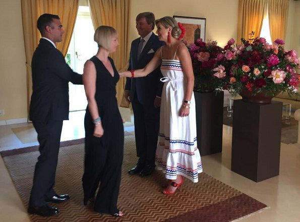 Queen Maxima wore a linen maxi dress by LISA MARIE FERNANDEZ and Oscar de la RentaBeaded Tassel Earrings