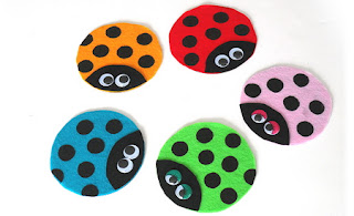 http://craftsbyamanda.com/recycled-cd-ladybugs/