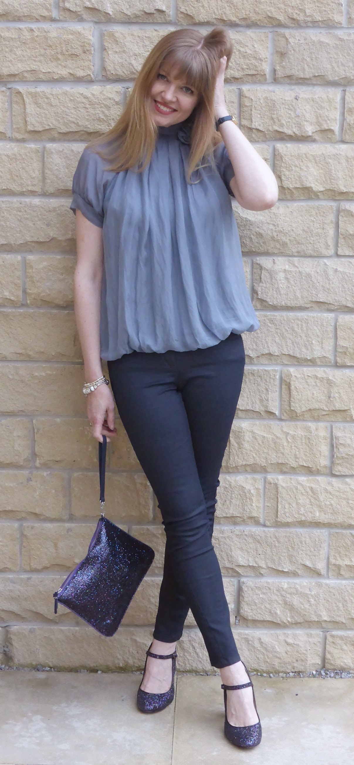 What LIzzy LOves over 40 fashion blogger wears grey silk top from Phase Eight with rose detail, grey skinny coated jeans and multi-coloured glitter Mary Jane shoes