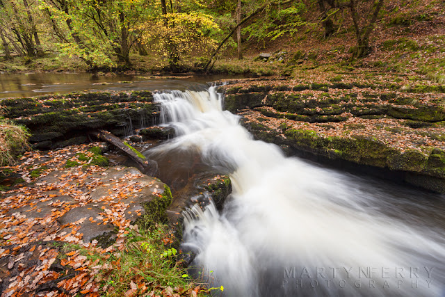 A small waterfall in the Brecon Beacons with autumn leaves by Martyn Ferry Photography