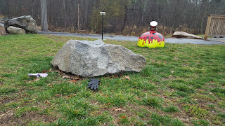 "maybe a new piece has been added to the Sculpture Park. possibly titled ""2 mismatched gloves by the rock"""