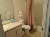 Bathroom in model apartment  in the U.S. with a double layered  shower curtain.