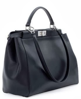 664ce819e96e I would be the happiest girl in the world. Why, you ask? Because, it looks  like a regular black leather bag.