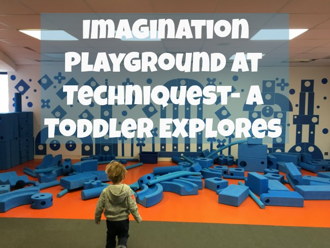 Imagination-playground-at-techniquest-a-toddler-explores-text-over-image-of-toddler-standing-in-front-of-blue-blocks