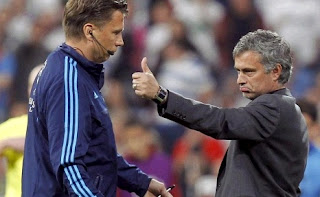 Mourinho faces a referee in a UEFA match
