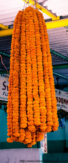 Marigold flowers garland in Gudimalakpur flower market hyderabad