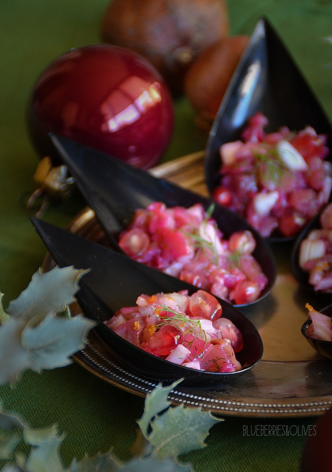 APPETIZER ON A SPOON WITH SALMON, FENNEL AND POMEGRANATE