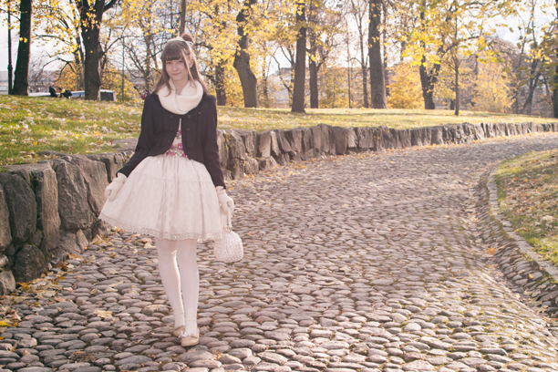 a finnish lolita posing in front of an autumn scenery