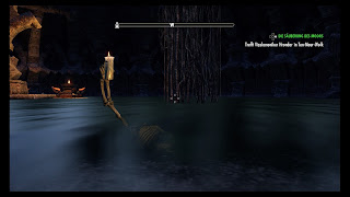 Skeleton holding a candle above water level