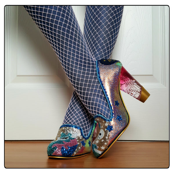 crossed legs with glitter unicorn shoes and metallic tights