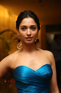 Actress Tamannaah Pictures in Blue Long Dress at Abhinetri Audio Launch  0004