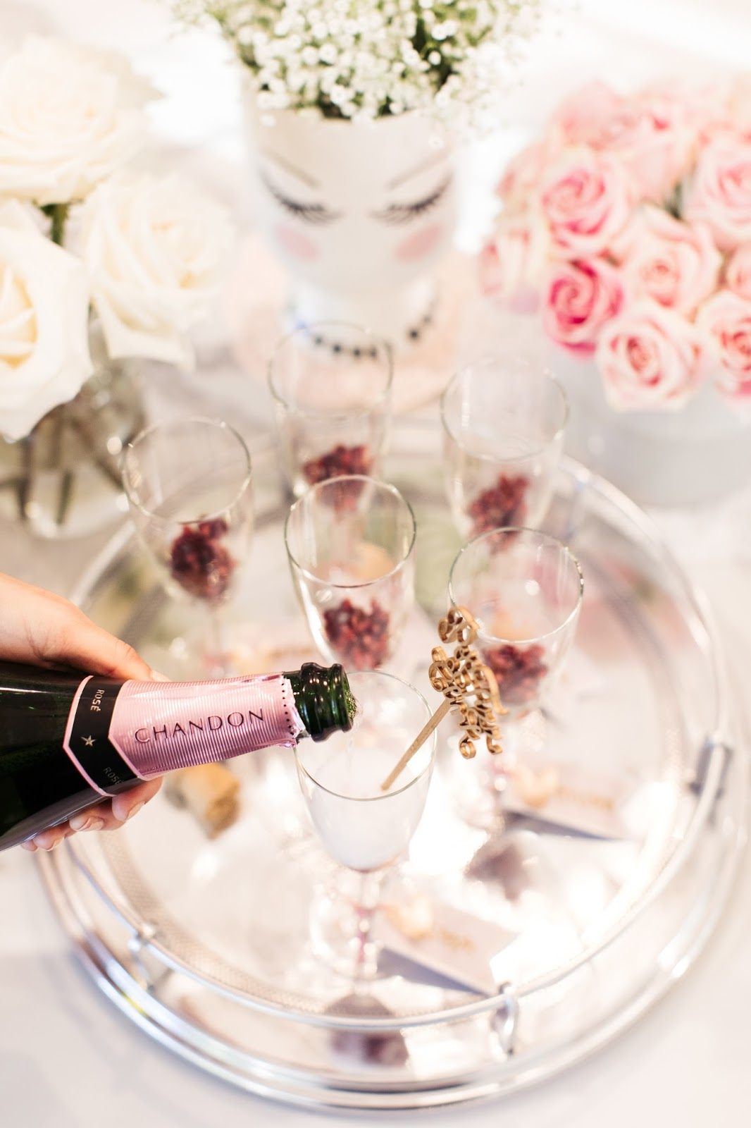 Add Pomegranate seeds to the bottom of your champagne flute for a sweet compliment to Chandon sparkling rose.